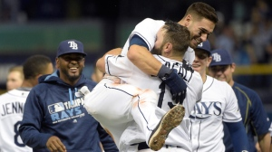 Tampa Bay Rays' Curt Casali (19) is congratulated by teammate Kevin Kiermaier after hitting a walk-off baseball game-winning RBI-single during the ninth inning against the Toronto Blue Jays in St. Petersburg, Fla., Saturday, April 30, 2016. (AP Photo/Phelan M. Ebenhack)