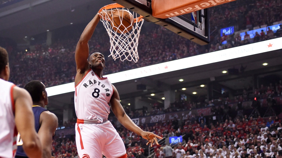 Toronto Raptors forward Bismack Biyombo dunks the ball during first half round one NBA playoff basketball action against the Indiana Pacers in Toronto on Sunday, May 1, 2016. THE CANADIAN PRESS/Frank Gunn