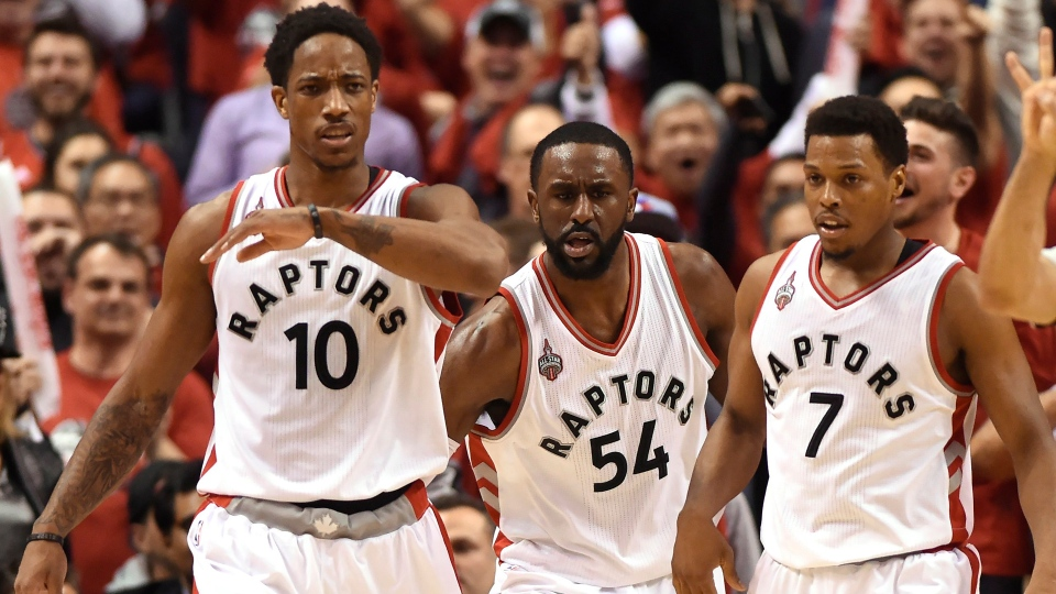 Toronto Raptors guard DeMar DeRozan, left, celebrates with teammates Patrick Patterson (54) and Kyle Lowry (7) after scoring a two point shot with while being fouled during second half round one NBA playoff basketball action against the Indiana Pacers in Toronto on Sunday, May 1, 2016. THE CANADIAN PRESS/Frank Gunn