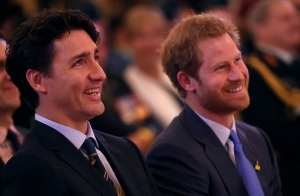Prince Harry, right, looks on laughing alongside Canadian Prime Minister Justin Trudeau during a ceremony to promote the 2017 Invictus Games, which the city will be hosting, on Monday, May 2, 2016. THE CANADIAN PRESS/Nathan Denette