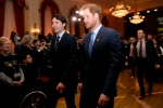 Prince Harry and Canadian Prime Minister Justin Trudeau receive applause as they leave a ceremony to promote the 2017 Invictus Games, which the city will be hosting, on Monday, May 2, 2016. THE CANADIAN PRESS/Nathan Denette