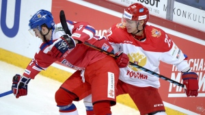 Russia's Nikita Zaitsev, right, tries to slow down Czech's Tomas Filippi during the Euro Hockey Tour Karjala Cup match between Russia and Czech Republic in Helsinki, Finland, on Sunday Nov. 8, 2015. The Toronto Maple Leafs signed KHL defenceman Zaitsev to a one-year entry-level contract on Monday. THE CANADIAN PRESS/ Martti Kainulainen / Lehtikuva via AP) FINLAND OUT - NO SALES