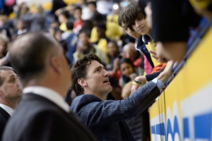 Prime MinisterJustin Trudeau talks with people in the stands after a sledge hockey game during the Prince's visit to Toronto to promote the 2017 Invictus Games, which the city will be hosting, in Toronto on Monday, May 2, 2016. THE CANADIAN PRESS/POOL/Nathan Denett