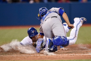 Toronto Blue Jays Michael Saunders, left, is tagged out at home plate by Texas Rangers catcher Brett Nicholas for an inning-ending double play during eighth inning American League baseball action in Toronto on Monday, May 2, 2016. (The Canadian Press/Frank Gunn)