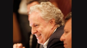 Quebec Premier Jean Charest smiles during the New England Governors and Eastern Canadian Premiers conference on Monday, July 30, 2012 in Burlington, Vt. The officials from the United States and Canada passed a resolution Monday to work together to increase the flow of clean energy. (AP Photo/Toby Talbot)