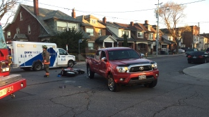 Police say a motorcyclist suffered a severe head injury following a collision in St. Clair West Village.  (Mike Nguyen/ CP24)