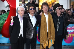 Members of the band The Rolling Stones, from left, Charlie Watts, Ronnie Wood, Mick Jagger and Keith Richards pose for photographers upon arrival at the Rolling Stones Exhibitionism preview in London, Monday, April 4, 2016. (Photo by Joel Ryan/Invision/AP)
