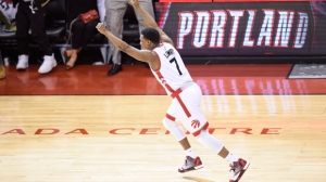 Toronto Raptors' Kyle Lowry (7) reacts after making a buzzer beater three point basket to tie the game against the Miami Heat during game one second round NBA playoff basketball action in Toronto on Tuesday, May 3, 2016. THE CANADIAN PRESS/Nathan Denette