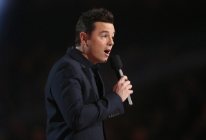In a Monday, Feb. 15, 2016 file photo, Seth MacFarlane presents the award for best musical theater album at the 58th annual Grammy Awards, in Los Angeles. (Photo by Matt Sayles/Invision/AP)