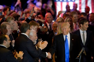 Republican presidential candidate Donald Trump greets supporters as he arrives for a primary night news conference, Tuesday, May 3, 2016, in New York. (AP Photo/Mary Altaffer)