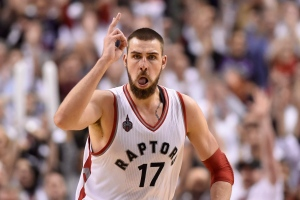 Toronto Raptors' Jonas Valanciunas (17) reacts after scoring during overtime NBA playoff basketball action against the Miami Heat in Toronto on Thursday, May 5, 2016. (The Canadian Press/Frank Gunn)