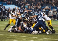 Hamilton Tiger-Cats push for a first down against the Toronto Argonauts during second half CFL action in Toronto on Friday, September 11, 2015. The THE CANADIAN PRESS/Aaron Vincent Elkaim