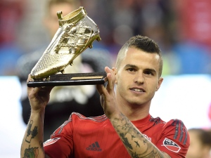 Toronto FC's Sebastian Giovinco holds his golden boot trophy before playing Dallas FC in first half MLS soccer action in Toronto on Saturday, May 7, 2016. (The Canadian Press/Frank Gunn)