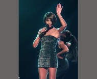 """In this March 26, 1999 file photo, Whitney Houston performs """"It's Not Right, But It's Okay"""" at the 13th annual Soul Train Music Awards in Los Angeles. (AP Photo/Mark J. Terrill, File)"""