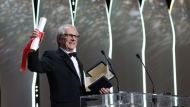 Director Ken Loach reacts after winning the Palme d'or for the film I, Daniel Blake, during the awards ceremony at the 69th international film festival, Cannes, southern France, Sunday, May 22, 2016. (AP Photo/Thibault Camus)