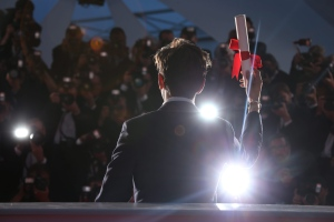 Director Xavier Dolan poses for photographers with his Grand Prix prize for the film Juste La Fin du Monde (It's Only The End OF the World) during the photo call following the awards ceremony at the 69th international film festival, Cannes, southern France, Sunday, May 22, 2016. (AP Photo/Joel Ryan)