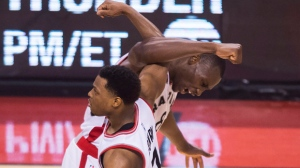 Toronto Raptors centre Bismack Biyombo (8) celebrates with Toronto Raptors guard Kyle Lowry (7) while playing against the Cleveland Cavaliers during second half Eastern Conference final NBA playoff basketball action in Toronto on Monday, May 23, 2016. THE CANADIAN PRESS/Nathan Denette