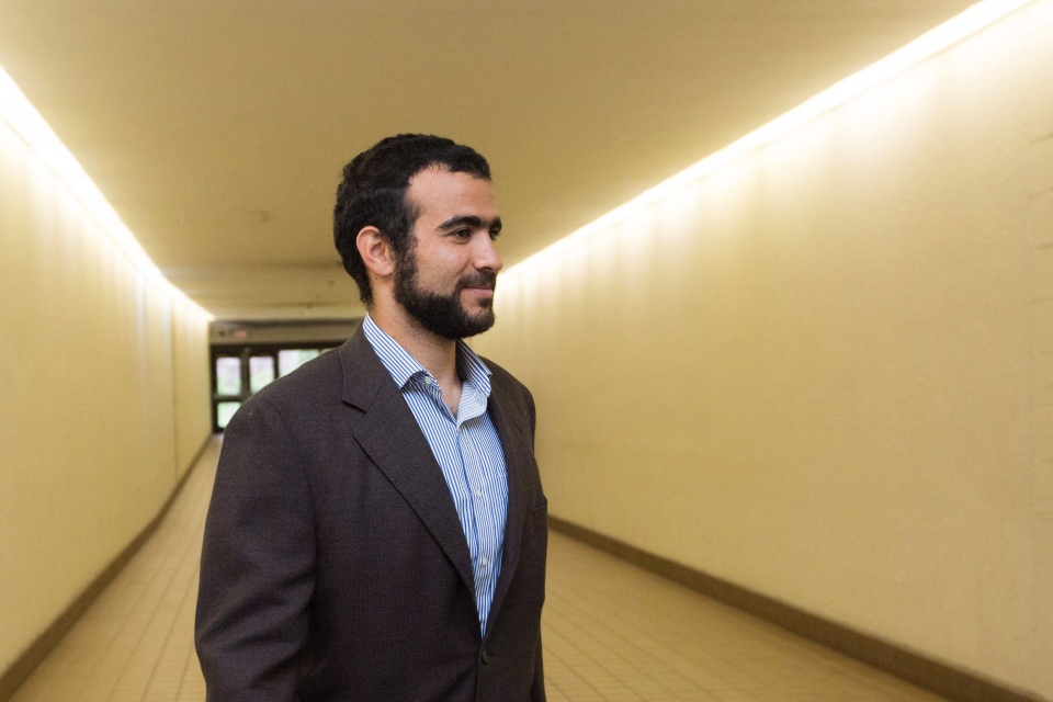 Omar Khadr leaves court after a judge ruled to relax bail conditions in Edmonton on Friday, Sept. 18, 2015. (The Canadian Press/Amber Bracken)