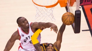 Toronto Raptors centre Bismack Biyombo (8) rejects Cleveland Cavaliers guard Kyrie Irving (2) during first half Eastern Conference final NBA playoff basketball action in Toronto on Saturday, May 21, 2016. THE CANADIAN PRESS/Nathan