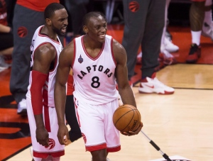 Toronto Raptors centre Bismack Biyombo (8) smiles with teammate Raptors forward Patrick Patterson (54) while playing against the Cleveland Cavaliers during second half Eastern Conference final NBA playoff basketball action in Toronto on Monday, May 23, 2016. THE CANADIAN PRESS/Nathan Denette