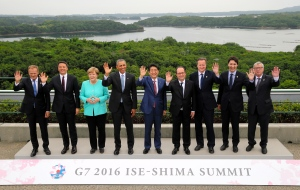 Japanese Prime Minister Shinzo Abe, center, waves with other leaders of Group of Seven industrial nations, from left, European Council President Donald Tusk, Italian Prime Minister Matteo Renzi, German Chancellor Angela Merkel, U.S. President Barack Obama, Abe, French President Francois Hollande, British Prime Minister David Cameron, Canadian Prime Minister Justin Trudeau and European Commission President Jean-Claude Juncker as they pose for the family photo during the first day of the G-7 summit meetings in Shima, Japan, Thursday, May 26, 2016. (Japan Pool via AP)