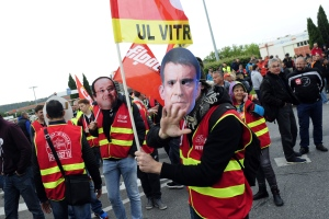 Union activists wearing masks of French Prime Minister Manuel Valls, right, and French President Francois Hollande, demonstrate while blocking the entrance of the industrial area in Vitrolles near Marseille, southern France, on a day of nationwide strikes and protests over a labor reform, Thursday, May 26, 2016. French Prime Minister Manuel Valls says he is open to 'improvements and modifications' in a labor bill that has sparked intensifying strikes and protests, but will not abandon it. (AP Photo/Franck Pennant)