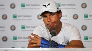 Nine-time champion Rafael Nadal announces he is pulling out of the French Open because of an injury to his left wrist during a press conference at the Roland Garros stadium in Paris, France, Friday May 27, 2016. The left-handed Nadal made the announcement at a hastily arranged news conference Friday, one day before he would have been scheduled to play his third-round match. (AP Photo/Michel Euler)