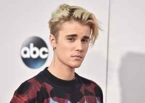 "FILE - In this Sunday, Nov. 22, 2015 file photo, Justin Bieber arrives at the American Music Awards at the Microsoft Theater in Los Angeles. A singer songwriter has sued Bieber and Skrillex for copyright infringement over their multi-platinum song, ""Sorry."" Casey Dienel, who performs under the name White Hinterland, filed suit against the two performers as well as their publishing companies, Universal Music and co-writers in federal court in Nashville, Tennessee, on Wednesday, May 25, 2016, which claims that ""Sorry"" uses a vocal riff from her song ""Ring the Bell."" (Photo by Jordan Strauss/Invision/AP, File)"