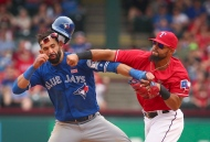 Toronto Blue Jays Jose Bautista (19) is punched by Texas Rangers second baseman Rougned Odor (12) after Bautista slid into second in the eighth inning of a baseball game at Globe Life Park in Arlington, Texas, Sunday, May 15, 2016. (The Canadian Press/AP-Richard W. Rodriguez/Star-Telegram via AP)