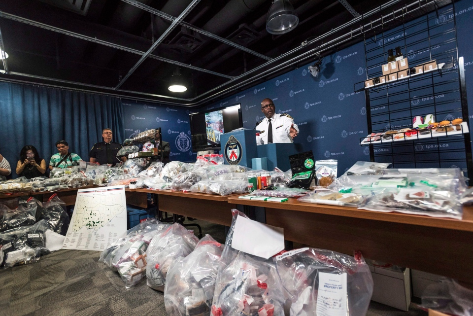 Toronto Police Chief Mark Saunders, surrounded by marijuana products including edibles and oils, speaks during a press conference to discuss results of a series of police raids conducted on companies allegedly selling marijuana illegally, dubbed Project Claudia, in Toronto on Friday, May 27, 2016. (The Canadian Press/Aaron Vincent Elkaim)