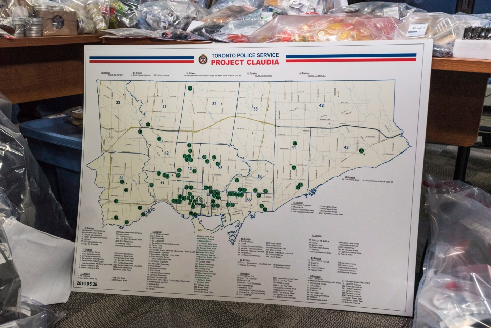 Marijuana products, including edibles and oils, which were confiscated by Toronto police are seen at a press conference displayed around a map of locations which were the subjects of a series of police raids conducted on companies allegedly selling marijuana illegally, dubbed Project Claudia, in Toronto on Friday, May 27, 2016. (The Canadian Press/Aaron Vincent Elkaim)