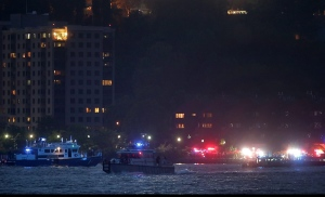 In this photo taken from video, search and rescue boats look for a small plane that went down in the Hudson River, Friday, May 27, 2016, near West New York, N.J. (AP Photo/Julie Jacobson)
