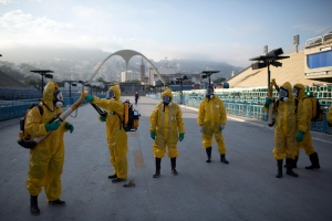 FILE - In this Tuesday, Jan. 26, 2016 file photo, health workers get ready to spray insecticide to combat the Aedes aegypti mosquitoes that transmits the Zika virus, under the bleachers of the Sambadrome in Rio de Janeiro, which will be used for the Archery competition in the 2016 summer games. More than 145 public health experts signed an open letter to the World Health Organization on Friday, May 27, 2016 asking the U.N. health agency to consider whether the Rio de Janeiro Olympics should be postponed or moved because of the ongoing Zika outbreak. The letter calls for the games to be delayed or relocated 'in the name of public health.' (AP Photo/Leo Correa, File)