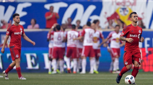 Toronto FC forward Sebastian Giovinco, right, reacts as the New York Red Bulls celebrate after scoring a goal during the first half of an MLS soccer game on Saturday, May 28, 2016, in Harrison, N.J. (AP Photo/Adam Hunger)