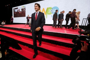 Prime Minister Justin Trudeau leaves the stage after a board photo at the closing ceremonies of the 2016 Liberal Biennial Convention Winnipeg Saturday, May 28, 2016. THE CANADIAN PRESS/John Woods