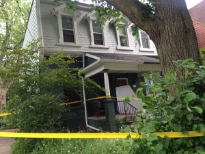 Police tape is seen outside a house on First Avenue on Sunday, May 29, 2016.