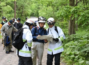 Rescuers search for a 7-year-old boy who is missing in a Japanese forest in Nanae town, on Hokkaido, the northernmost of Japan's four main islands Monday, May 30, 2016. He has been missing since late Saturday afternoon after his parents reportedly made him get out of the car as punishment. (Kyodo News via AP)