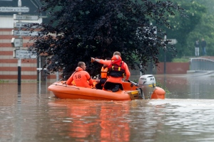 Rescuers row a life boat to evacuate local residents from flooded areas in Bruay La Buissieres, northern France, Tuesday, May 31, 2016.  (AP Photo/Michel Spingler)