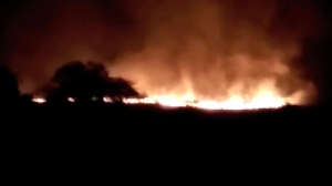 In this image made from video of K.K.Productions, a huge fire is seen at the Pulgaon ammunition depot in Pulgaon in the Indian state of Maharastra, Tuesday, May 31, 2016. A fire broke out at a major ammunitions depot in western India early Tuesday, causing fatalities, officials said.  (K.K. Productions via AP)