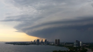A major storm cloud moves over Etobicoke as it passes through southern Ontario on Sunday, August 2, 2015. THE CANADIAN PRESS/Donna Lypchuk
