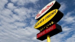 The sign of a Tim Hortons is pictured in downtown Kingston, Ont., on Nov. 18, 2015. (The Canadian Press/Lars Hagberg)