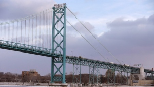 In a photo from Jan. 6, 2015 in Detroit, the Ambassador Bridge leading into Windsor, Ontario is seen from Detroit. (AP Photo/Carlos Osorio)