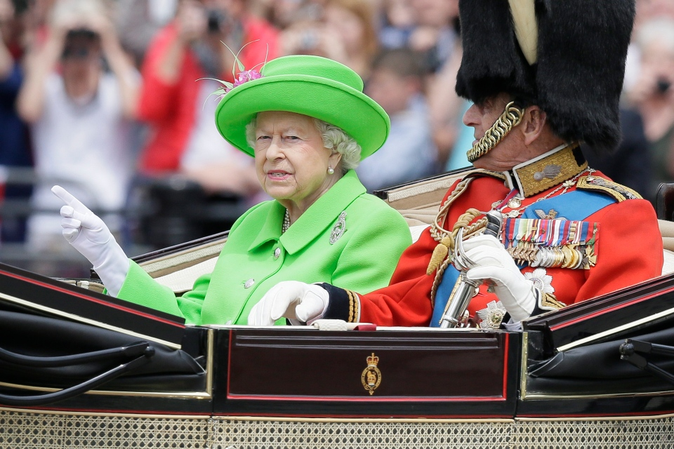 Britain's Queen Elizabeth II and Prince Philip ride in a carriage during the Trooping The Colour parade at Buckingham Palace, in London, Saturday, June 11, 2016. (AP Photo/Tim Ireland)
