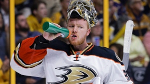 Anaheim Ducks goalie Frederik Andersen, of Denmark, takes a drink during the second period of Game 4 in an NHL hockey first-round Stanley Cup playoff series against the Nashville Predators on Thursday, April 21, 2016, in Nashville, Tenn. (AP Photo/Mark Humphrey)