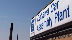 A sign outside Oshawa's General Motors car assembly plant is shown in Oshawa, Ont., Sept.17, 2012. THE CANADIAN PRESS/Michelle Siu