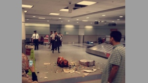 Baggage lies on the ground after crashing through the ceiling at a Terminal 3 baggage hall at Toronto Pearson International Airport Thursday June 23, 2016 in this image sent by a viewer. (submitted)