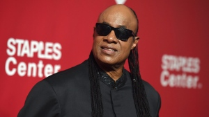 Stevie Wonder arrives at the MusiCares Person of the Year tribute honoring Lionel Richie at the Los Angeles Convention Center on Saturday, Feb. 13, 2016. (Photo by Jordan Strauss/Invision/AP)