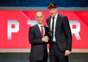 Jakob Poeltl, right, poses for a photo with NBA Commissioner Adam Silver after being selected ninth overall by the Toronto Raptors during the NBA basketball draft on Thursday, June 23, 2016, in New York. (AP Photo/Frank Franklin II)