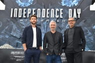 Director Roland Emmerich, center, and US actors Liam Hemsworth, left, and Jeff Goldblum, right, pose at a photo call for the Hollywood film 'Independence Day Resurgence' in front of the main station in Berlin, Germany, Thursday, June 9, 2016. (Jens Kalaene/dpa via AP)