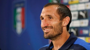 """Italy's Giorgio Chiellini smiles prior to the start of a press conference at the """"Casa Azzurri"""" in Montpellier, France, Friday, June 24, 2016. Italy will face Spain in a Euro 2016 round of 16 soccer match in Paris on Monday, June 27, 2016. (AP Photo/Antonio Calanni)"""